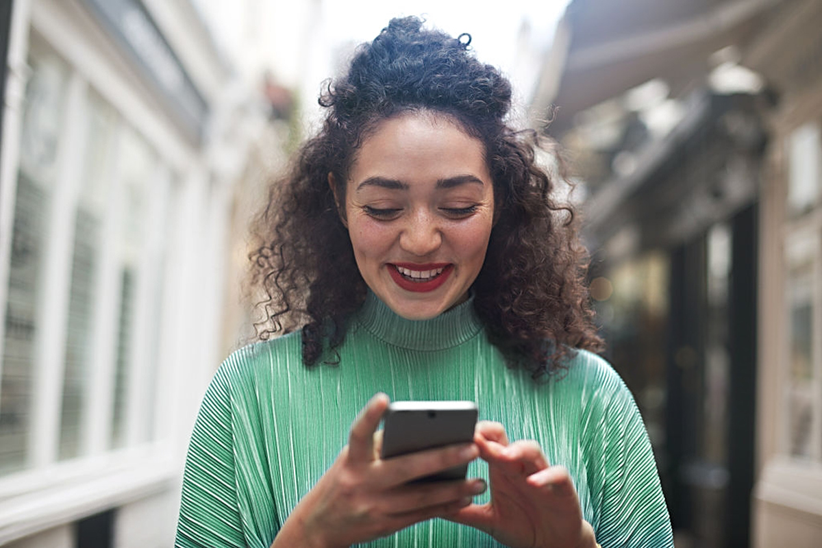 Girl in a green sweater on her phone
