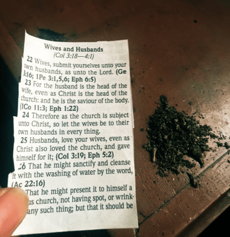 Woman tears out the part of the bible asking wives to be submissive and uses it to smoke weed