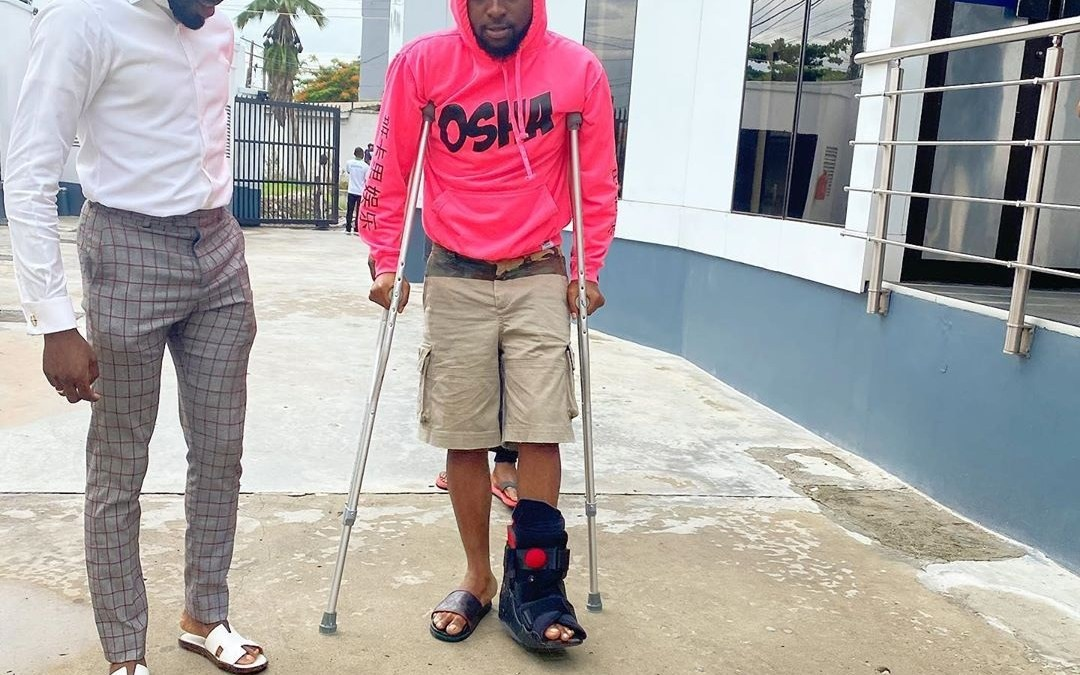 Popular International Nigeria singer Davido confined to crutches after sustaining a leg injury