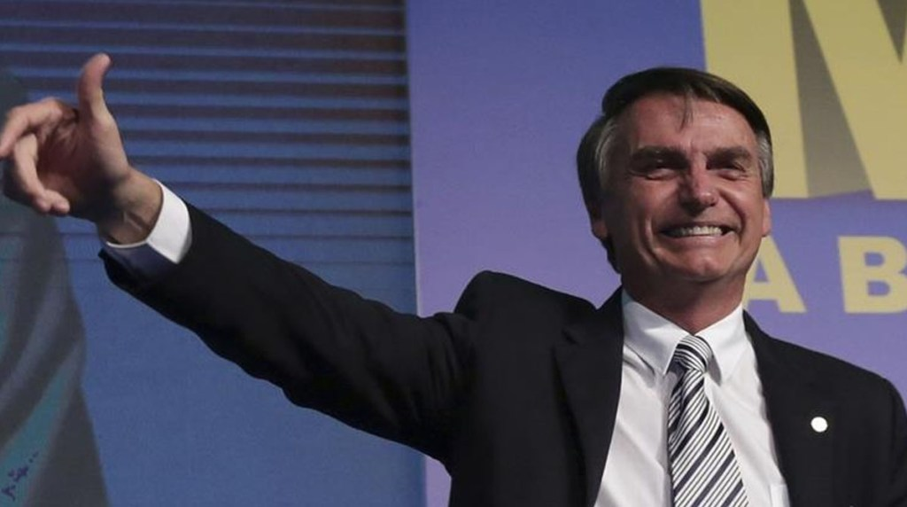 Jair Bolsonaro, Brazilian president threatens to knock a reporter in the mouth