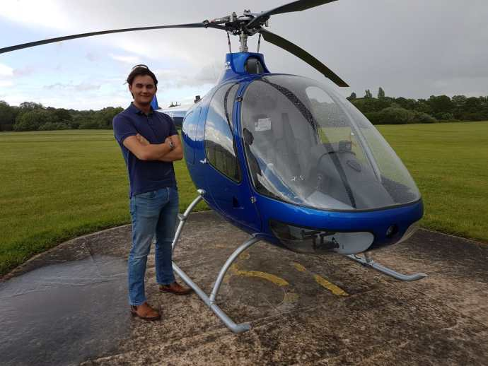 Liam after his first solo flight at EBG Helicopters