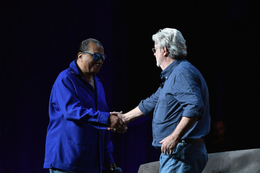 Billy Dee Williams and George Lucas shake hands atStar Wars Celebration Day 1 on April 13 in Orlando, Florida. Photo: Gustavo Caballero/Getty Images