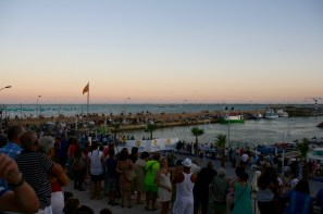L'Ampolla's harbour packed with spectators as the Virgin is carried to the boat that takes her out to sea
