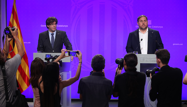 Carles Puigdemont and Junqueras at the announcement of the Catalan referendum act