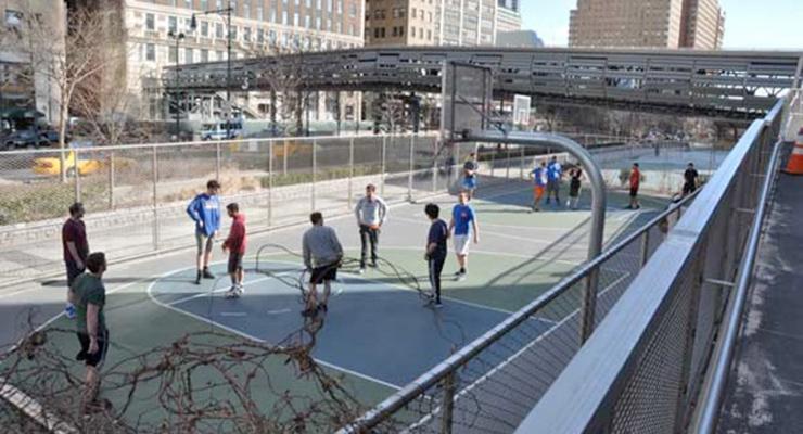 Guys playing Basketball on court