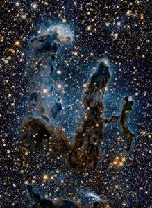 Here are the famous Pillars of Creation, viewed in the infrared. These 'pillars' are really vast clouds of dust, in which new stars are forming.