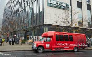 The Downtown Connection shuttle bus will soon be rerouted to Chambers Street, eliminating three stops along Warren Street, such as this one (at Greenwich Street), which is often used by Whole Foods customers.