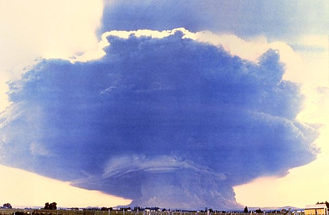 Rocky Kolberg - Rocky Kolberg The May 18 eruption. Composite photograph from 35 miles (60 km) west in Toledo, Washington. The ash-cloud stem is 10 miles (16 km) wide, and the mushroom top is 40 miles (64 km) wide and 15 miles (24 km) high. The footprint of the cloud stem is roughly the same as the devastated area north of the mountain where the forest was knocked down and which three decades later is still relatively barren.  Mt. St. Helens mushroom cloud, 40 miles wide and 15 miles high. Camera location: Toledo, Washington, 35 miles west-northwest of the mountain. The picture is a composite of about 20 separate images.