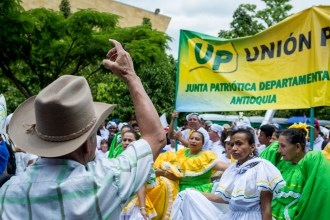 Members of the Union Patriotica chant slogans. 3000 members of this political wing of the FARC-EP formed during the 1985 peace talks were killed, decimating any possibility of political participation for the guerrillas.