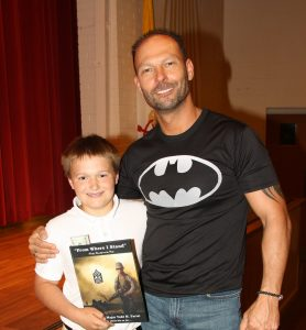 Motivational speaker presents to HS/MS students during assembly