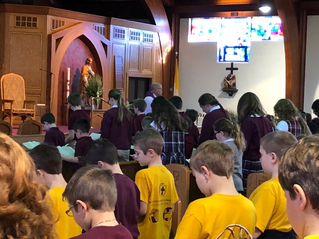 Elementary students participate in Easter prayer service