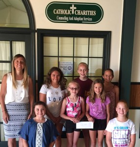 The Butterfly Club makes donation to local Catholic Charities