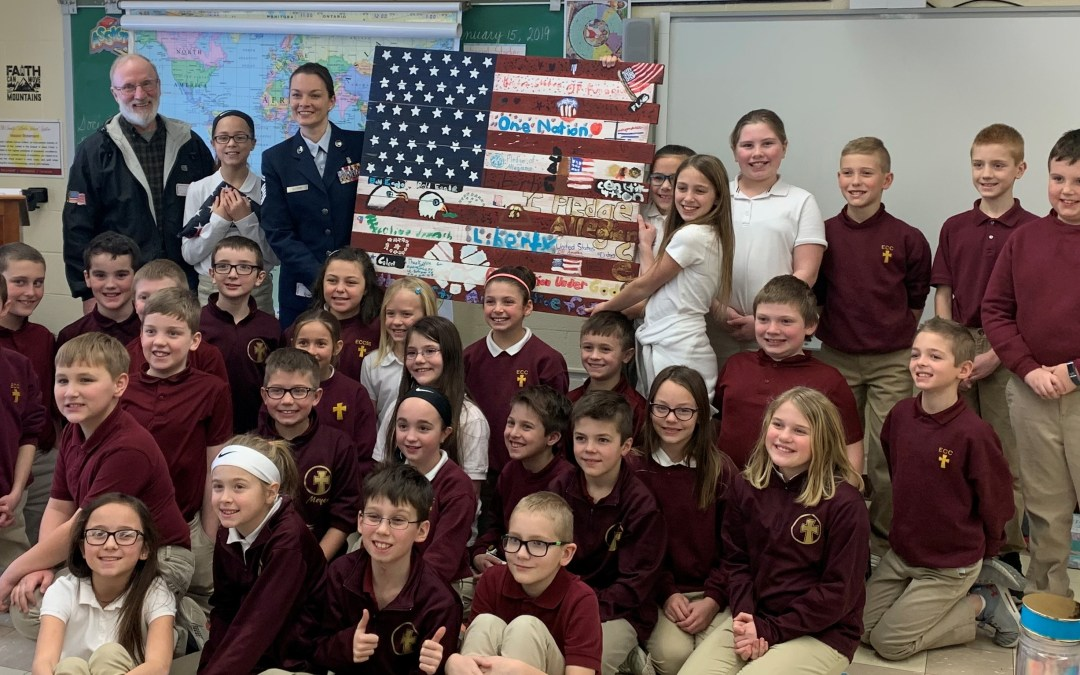 Guest speakers visit fourth-graders during lesson on symbolism