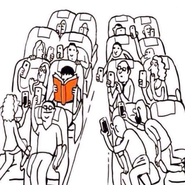 Cartoon about the wierdness of reading a hard-copy book