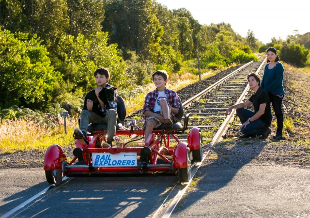 James and Charlie, with parents Alex and Mary-Joy, show how much fun rail carts would be if they were given the go-ahead. Photo Jeff Dawson