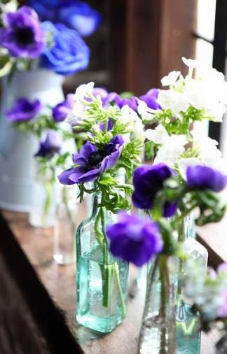 BOTTLES AND FLOWERS