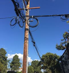 on the pole is the crossing of two messengers going off to the right down the alley we have hardline coaxial from catv fiber for the catv hybrid  [ 2448 x 3264 Pixel ]