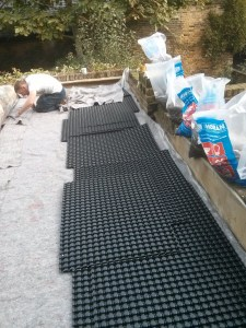 Installation of fleece and drainage layer