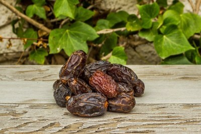 medjoul dates on a rustic table in a garden