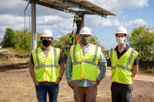 Volunteers in front of the first raised panel of the Lincoln Park Solar Garden