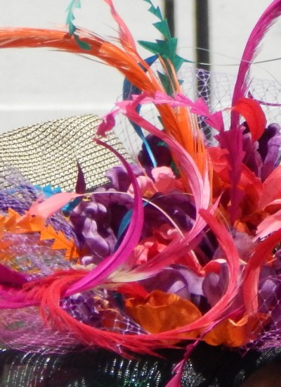 Hat with bright oranges reds and purples