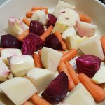 Root vegetables  in a cooking pan.