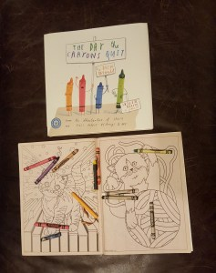 Book, coloring book and crayons