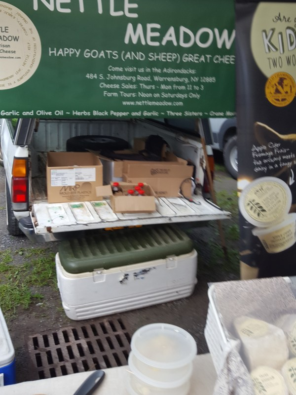 Display of cheese by Nettle Meadow Farm