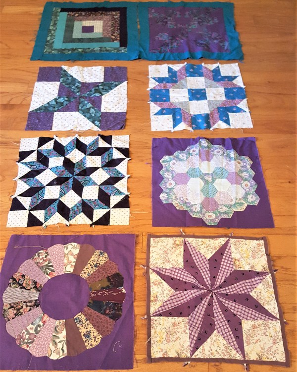 Eight quilt blocks in purple and teal