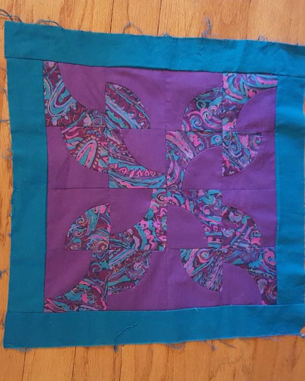 Quilt block in deep purple