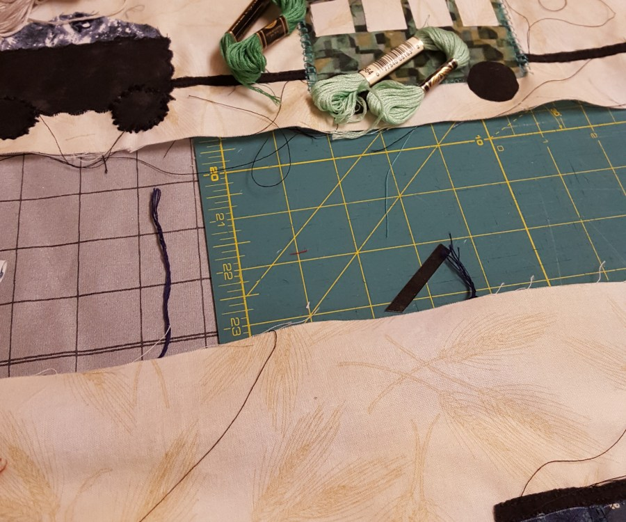 comparing colors of floss to quilt applique