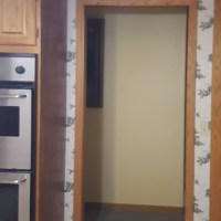 Open Doorway Bordered by Wall Paper