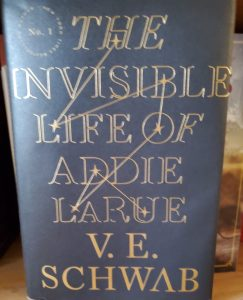 Dark Blue book cover of The Invisible Life of Addie Larue