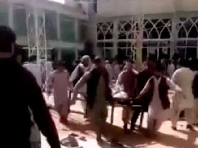 Taliban pledge to step up security as Shi'ite victims buried in Afghanistan