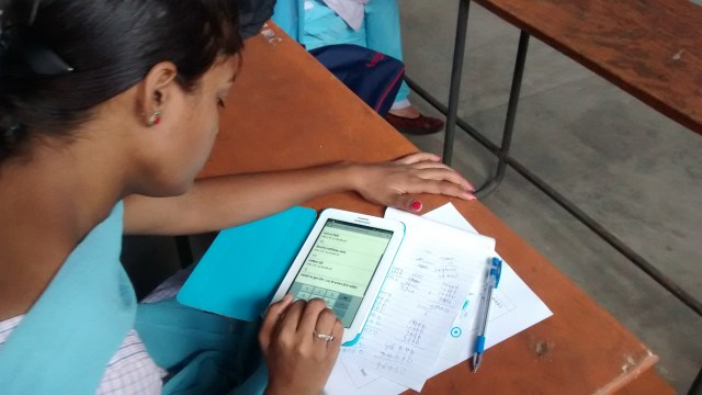 A student attempting the survey on an Android tablet. Photo by Tanvi Rao.
