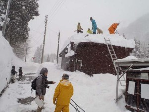 Some removed snow from the top of the public toilet hut in the community.