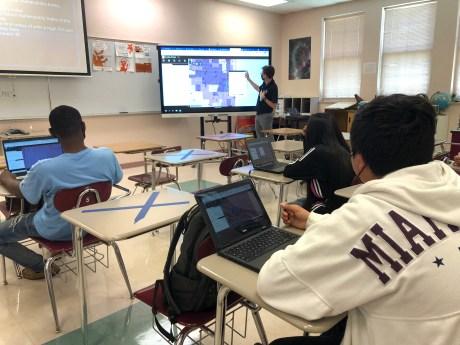 Lake Worth High School teacher Erik Johnson exploring social vulnerability on a GIS map with his students.