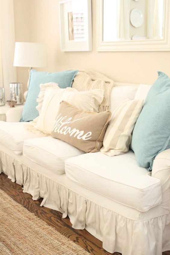 slipcovered-sofa-with-burlap-pillows-and-soft-accents