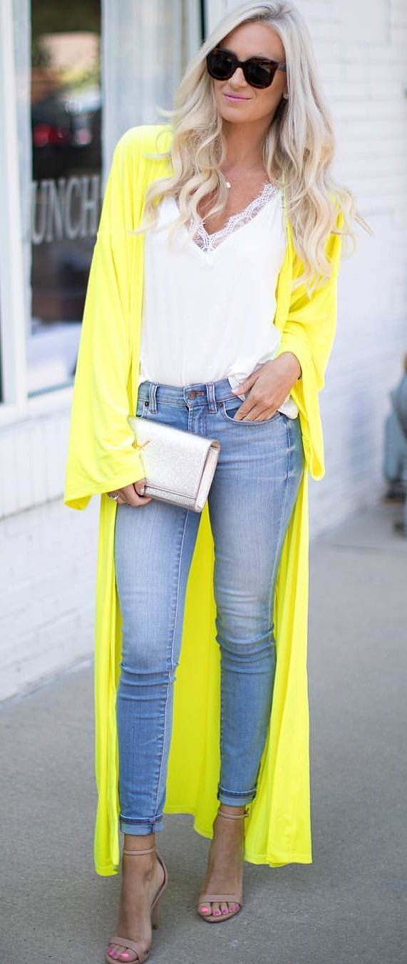 women's yellow cardigan. white plunging neckline lace floral blouse and blue denim high-waist jeans