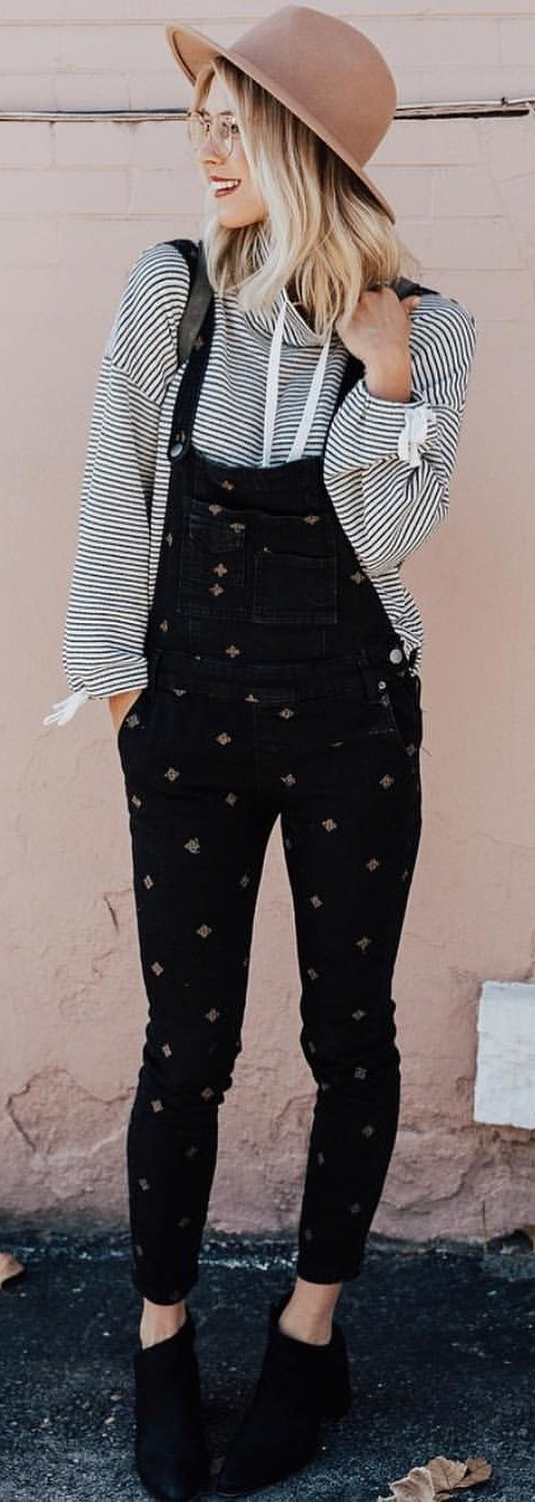 black denim overalls; black-and-white striped sweater with infinity scarf