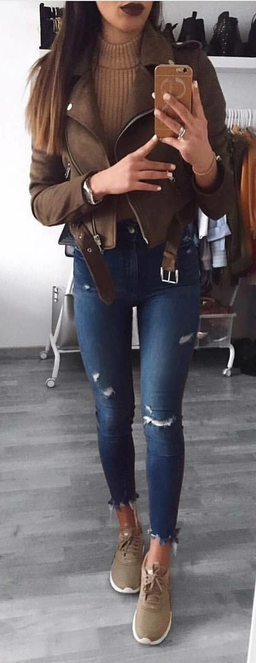 brown full-zip jacket and blue distress jeans