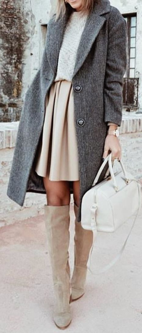 gray 2-button coat, nude-colored top and pleated skirt outfit