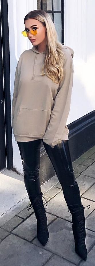 gray pullover hoodie; black pants outfit