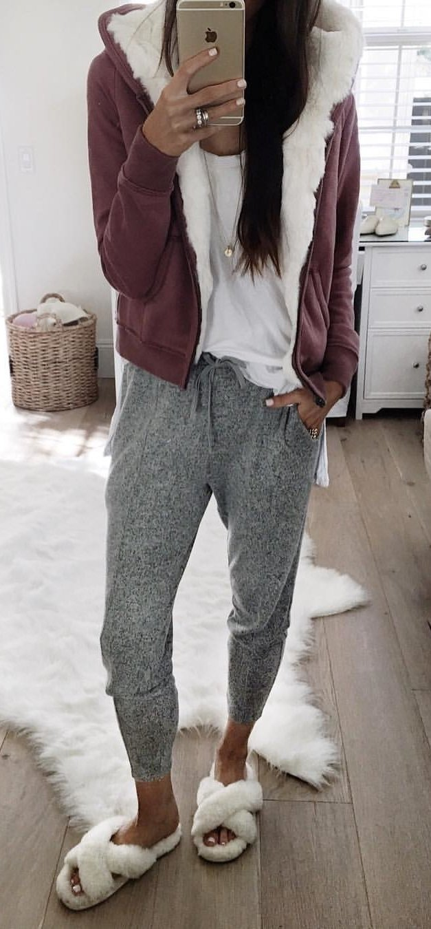 maroon and white coat and grey pants