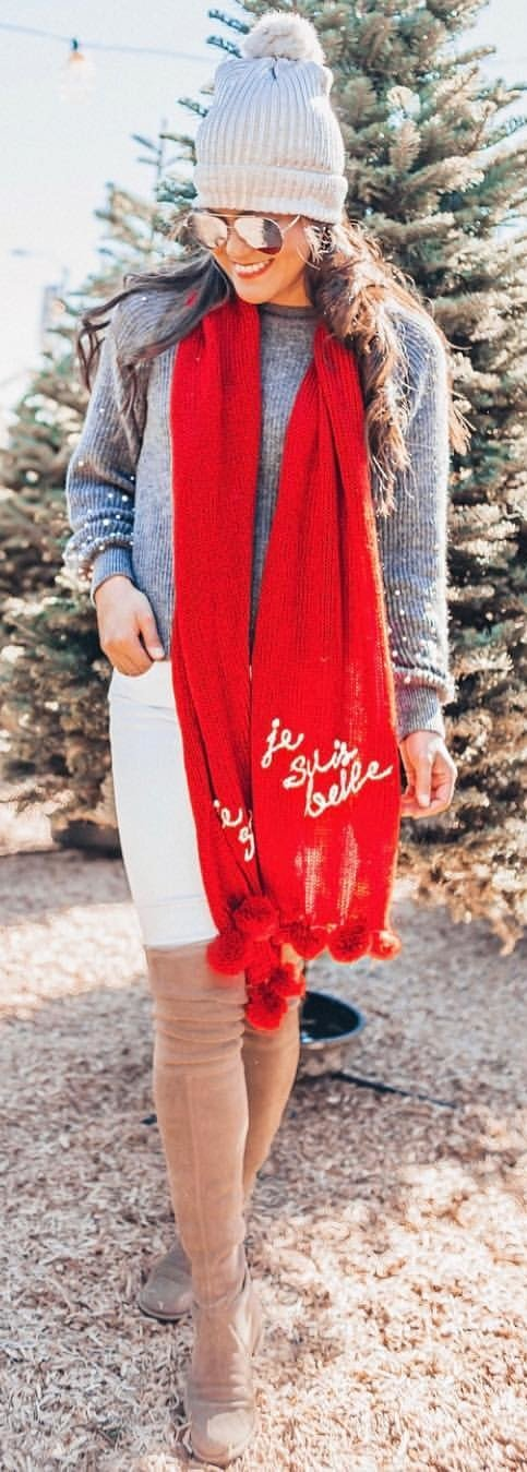 red scarf and gray bobble hat
