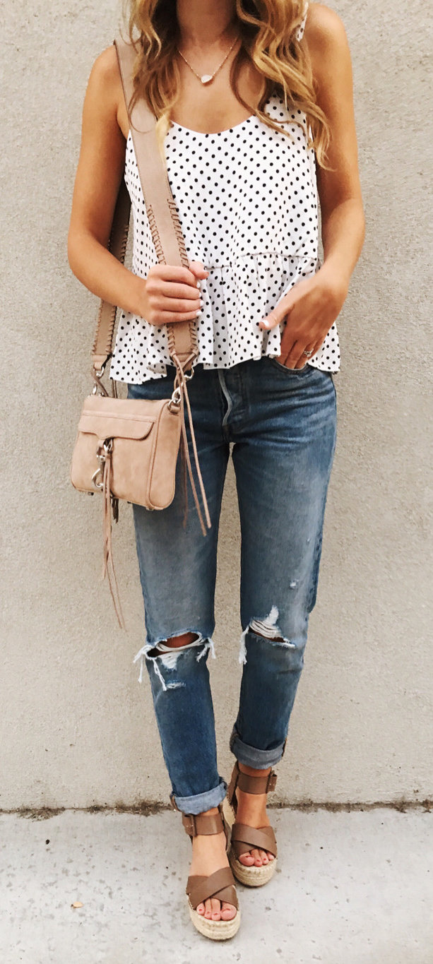 women's black and white polka-dot spaghetti strap top and distressed blue jeans