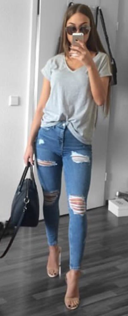 women's gray v-neck T-shirt and distressed blue skinny jeans outfit