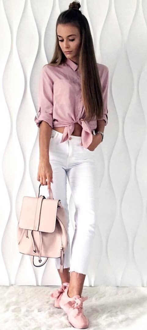 women's pink dress shirt; white skinny jeans; and white leather backpack