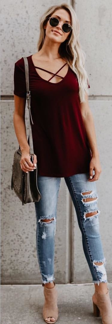 women's scoop-neck shirt and distressed blue denim jeans