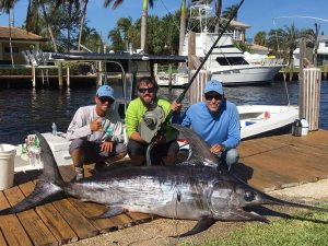 Left to right- Mate Danny, Tim Picket from Lindgren Pittman & Braden Escobar with a nice daytime Florida swordfish